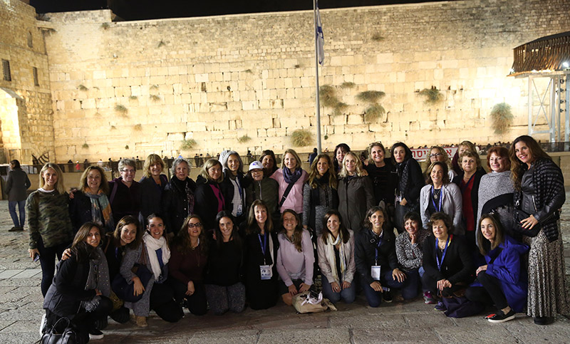 Members of the 2017 Israel Bonds National Women's Division Israel Delegation assemble in front of the Kotel