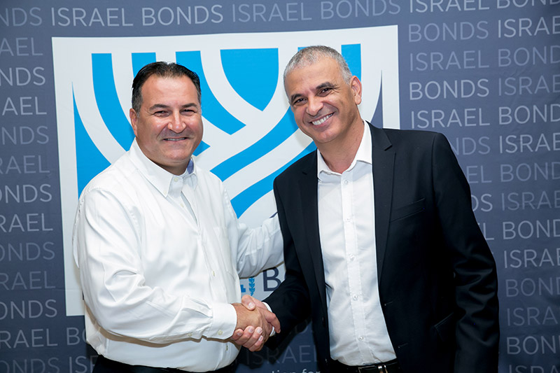 Israel Maimon welcomes Finance Minister Moshe Kahlon to Washington, DC, for a July 2017 Israel Bonds event (Photo: Freed Photography)