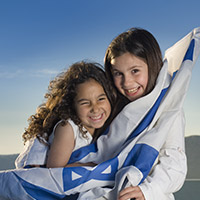 Girls wrapped in Israel Flag