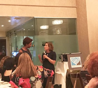 Pro-Israel activist Chloé Valdary addresses Israel Bonds' Women's Division Prime Minister's Circle members as Laura Orzy, chair of Women's Division, moderates Q&A session at La Brochette restaurant
