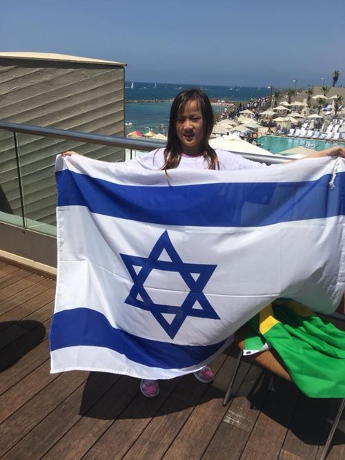 Gina's daughter Mia celebrates Yom Ha'atzmaut in Tel Aviv with the Bonds' Delegation