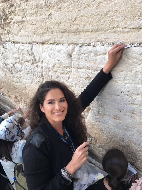 Jennifer places notes from family and friends, including her own, into the Kotel
