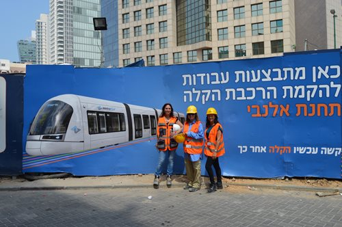 From left: NTA Spokesperson Galit Porat, visitor Diana Shoemaker and Israel Bonds International Business Development Director Sara Friedman next to a sign promising better days ahead