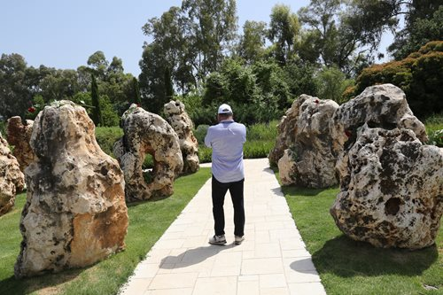 Israel Maimon engages in a moment of quiet reflection at a memorial for 73 IDF soldiers killed in a helicopter collision in 1997