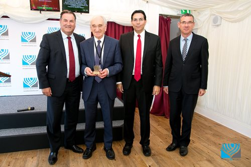 From left: Israel Bonds President & CEO Israel Maimon; Deputy Speaker of the House of Lords the Lord Simon Haskel; UN Ambassador Danny Danon; and Ambassador to the Court of St. James Mark Regev