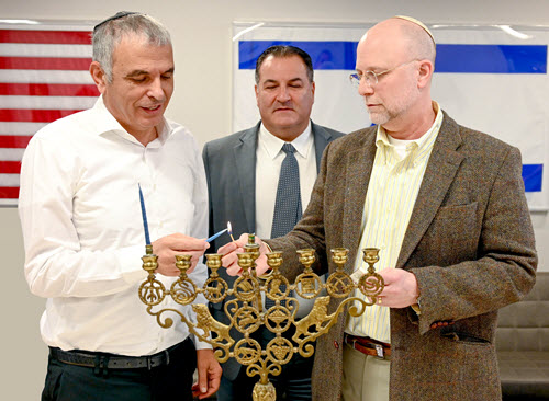Lighting the menorah at Bonds headquarters are, from left: Finance Minister Moshe Kahlon; President & CEO Israel Maimon; and Rabbi Martin Pasternak, national director of the Israel Bonds Synagogue and Rabbinic Division (Photo: Shahar Azran)