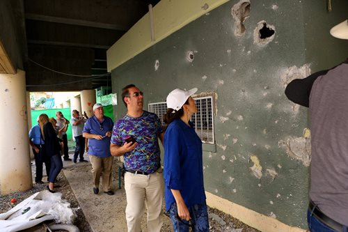 Delegates view shrapnel damage from rockets fired from Gaza at the border community of Sderot throughout May 4-5