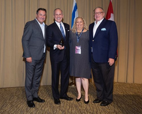 U.S. Special Envoy to Monitor and Combat Anti-Semitism Elan S. Carr (second from left) displays an Israel Bonds award presented by (from left) President & CEO Israel Maimon, Philadelphia lay leader Daryl Segal and Chairman of the Board Howard L. Goldstein