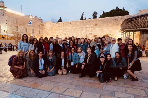Delegates gather for a group photo at the Kotel.