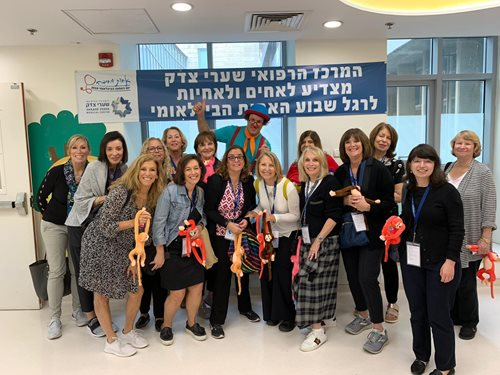Delegates provide toys to children at Shaare Zedek Medical Center's pediatric care unit.