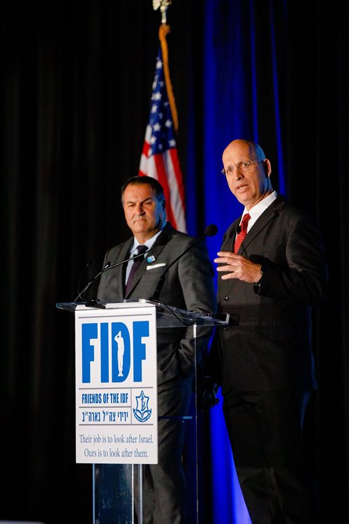Speaking at November's FIDF gala in Boston, Israel Maimon (left) shares behind-the-scenes details of Israel's attack on Syria's nuclear reactor (Photo by Nir Landau)